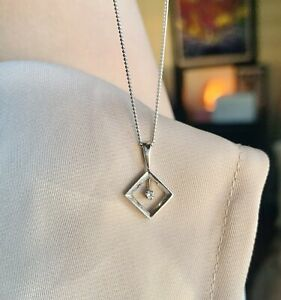 9ct White Gold Diamond Pendant and 45cm 9ct White Gold Chain.
