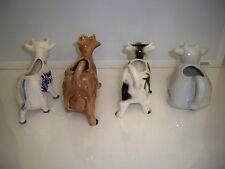 HERD OF VINTAGE COW CREAMERS (4) KITCHEN ACCESORIES