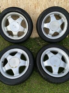 Ford Rs2000 Alloy Wheels With Good Condition Tyres X4