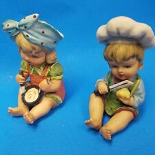 Lot Of 2 Vintage Hand Painted Bisque Ceramic Hummel Style Babies Cooking Figures