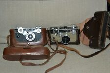 Two Vintage Argus Cameras with cases