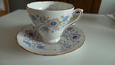 "Vintage Avon Tea Cup and Saucer ""Blue Blossoms"" English Bone China 1974"