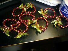 SET OF 8 poinsettia BEADED NAPKIN RINGS - Crate and Barrel