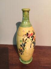 Pottery vase. Signed
