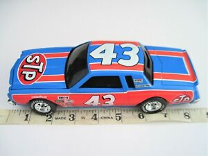 1:24 SCALE ACTION DIECAST CAR #43 RICHARD PETTY STP 1975 CHEVY MONTE CARLO (READ