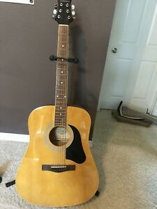 silvertone acoustic guitar. Left Strung. Barely Used. Pro Series