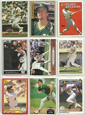 9 DIFFERENT MARK MCGWIRE BASEBALL CARDS IN A NEW 9 POCKET CARD PAGE