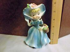 Southern Belle Wearing Blue Bonnet & Dress Carrying Flower Basket Figurine