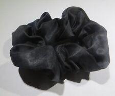 - Nœud brassard en tissu noir satiné  sur élastique