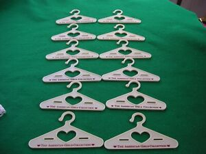 American Girl Doll Lot of 12 Clothes Hangers. Cream Color Hard Plastic.