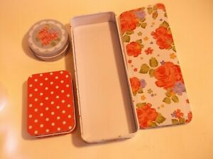 SET OF THREE LOVELY STORAGE TINS- BRAND NEW AND SEALED.