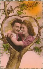 Couple Surrounded by Heart in Tree