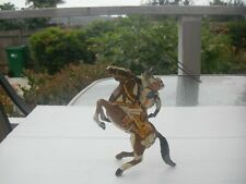 Vintage antique tin wind up Cowboy, with working lasso & 6 shooter