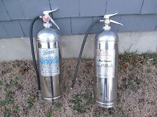 2 VINTAGE STAINLESS STEEL FIRE EXTINGUISHERS
