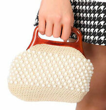 1950s vintage white crochet beaded bag with faux lucite amber handle