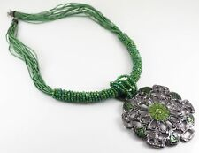 STATEMENT NECKLACE WITH LARGE SILVER AND GREEN PENDANT ON SEED BEAD SILKY THONG