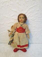 Ancienne petite poupée en tissu bourré