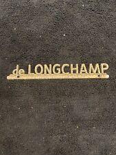Vintage de Longchamp car dealership emblem