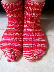 Hand knitted red striped socks