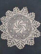 Vintage ecru round crocheted doily.
