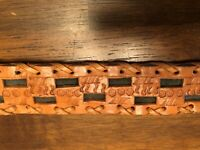 Vintage Belt and Buckle Western Tooled Leather Tan Cream Suede Background