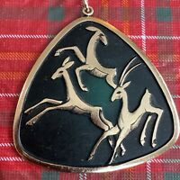 Vintage Brass And Black Gazelle Pendant