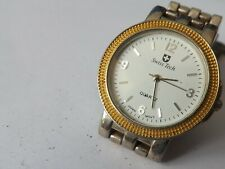 a vintage gents stainless steel cased quartz swiss tech watch