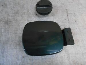 1997  Saturn sl2  Factory Fuel door with gas cap and mounting bolts color green