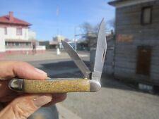 (Br) Case Xx pocket knife with quality dinosaur bone scales handles w/pouch