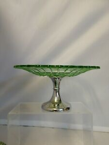 Vintage green cake stand with metal base.