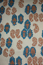 Vintage retro print fabric.  Blue and brown medallions.