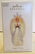 Hallmark 2009 ornament ANGEL OF PEACE on Earth insert light glowing wing QXT4222