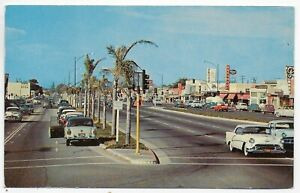 (5686) Old Postcard  Cars on Newport Blvd. by Stores  at  Costa Mesa California