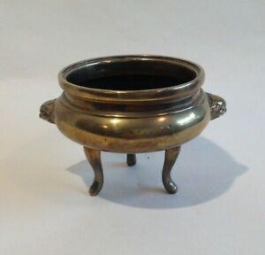Antique 19thc Chinese Bronze Censer with Bat faces on a tripod stand.