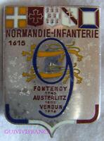 IN17797 - INSIGNE 9° Régiment d'Infanterie, NORMANDIE retirage R 1979, matriculé