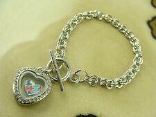 AUTISM awareness charm in 20mm Heart locket on a silver toggle chain bracelet