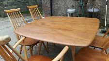 A Vintage retro Ercol drop leaf table and goldsmith chairs