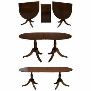 EXTENDING TILT TOP OVAL DINING TABLE IN THE REGENCY STYLE SOLID MAHOGANY CASTORS