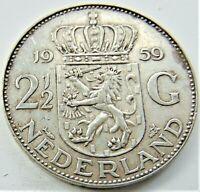 1959 NETHERLANDS Juliana, Silver 2-1/2 Gulden grading VERY FINE or better.