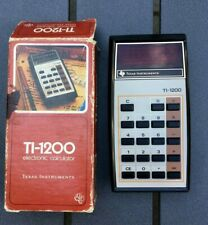 Vintage Texas Instruments electronic calculator Ti-1200 red numbers in box works