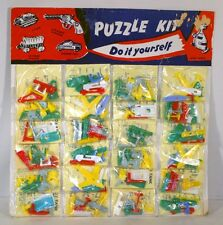 VTG PT PLASTIC PUZZLE KEYCHAIN STORE DISPLAY LOT 24 NOC TANK CANNON RACE CAR ++