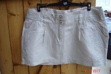 Mini jupe beige avec des fils dorés 4 poches et 4 boutons strass pimkie T 38