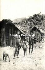 dutch new guinea, Armed Papua Hunters Koteka, Young Boy, Native Huts 1950s RPPC