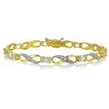 Gold Tone over Sterling Silver Blue Topaz and Diamond Accent Infinity Bracelet