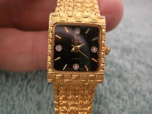 Vintage Oleg Cassini Quartz Watch ~ Goldtone & Black  ~ New Battery