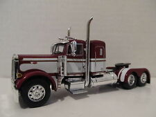 DCP 1/64 SCALE 379 PETERBILT(DAY CAB OPT) MAROON WITH WHITE SEMINOLE STRIPE