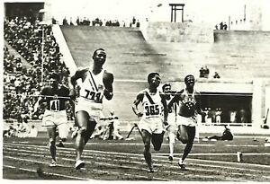 Extreme rare used postcard of Jesse Owens in action at 1936 Berlin Olympics