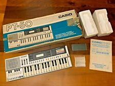 Casio PT-50 vintage keyboard , original box, Rom Pack RO-201, Manual, from 1983