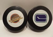TWO Vintage Vancouver Canucks Pucks - NEW!  1970 - 1978 Logo & 1978 - 1997 Logo