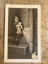 More details for real photo postcard. boy with doll.    ref559